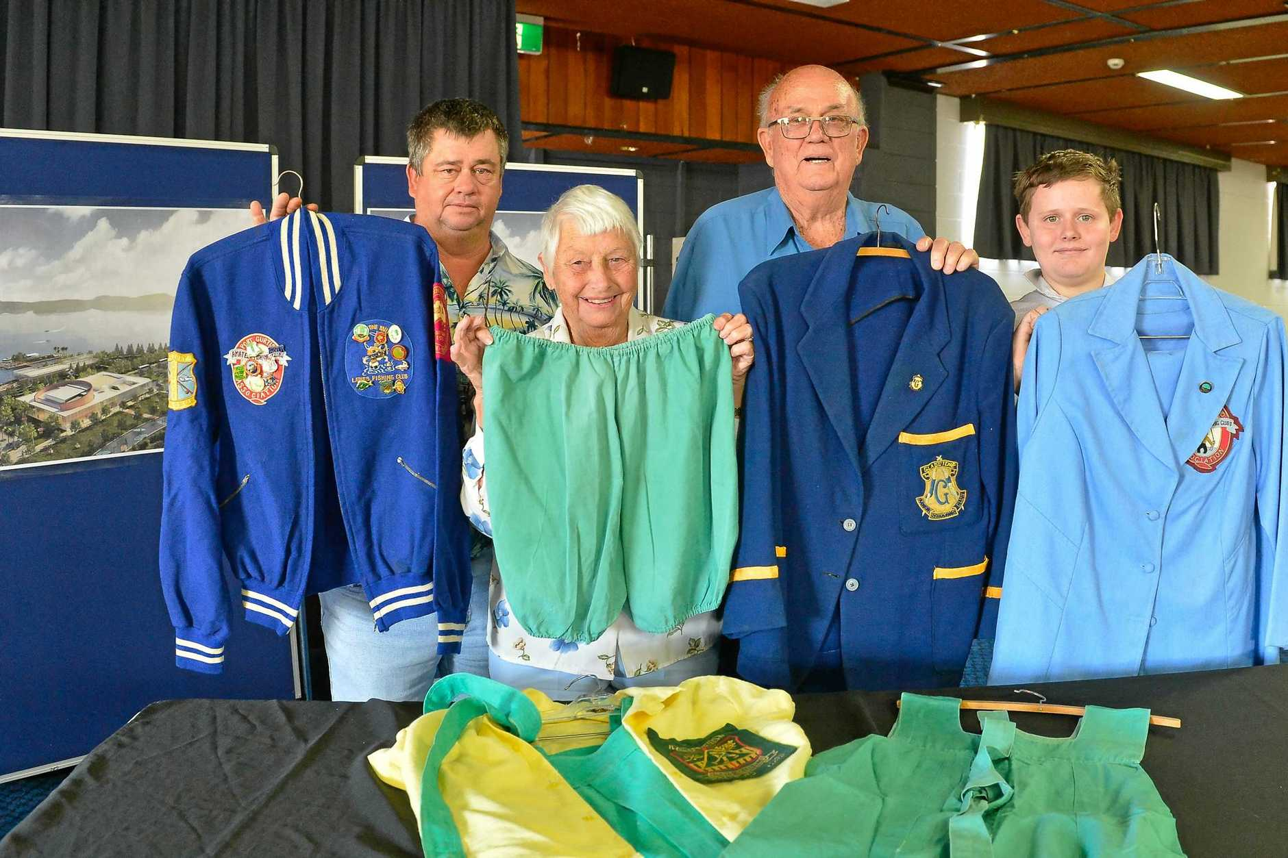 Patsy Lee's relatives John, Lorraine, Ron and Thomas Haslet with some of her old uniforms including the bloomers worn as goalie in hockey.