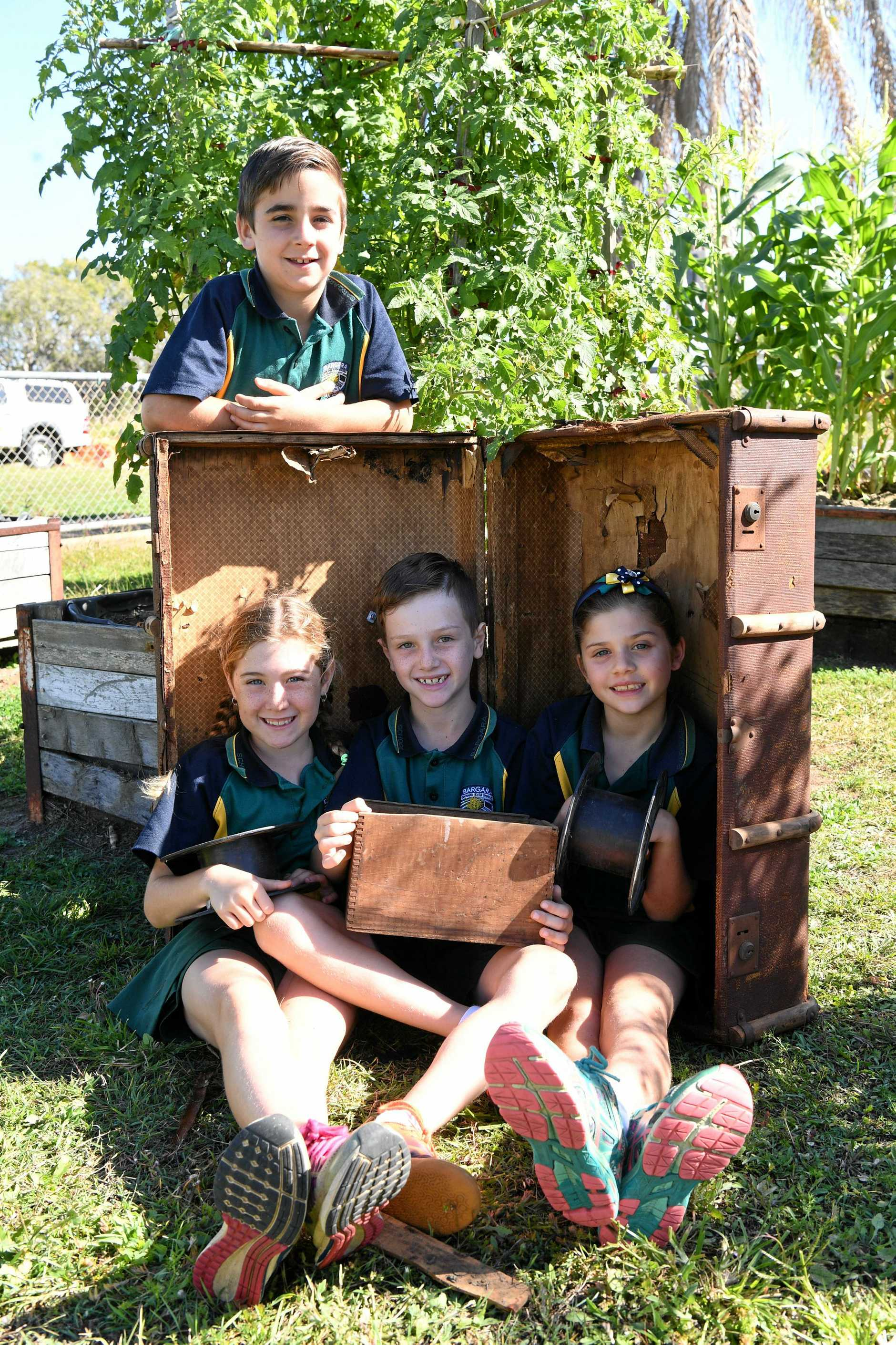 RECYCLED SCULPTURE PROJECT: Bargara State School year 3B students - Lacey, Wiel and Georgia (front), Tyson (back).