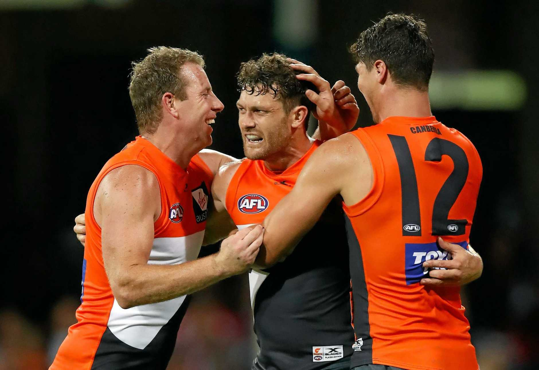 SYDNEY, AUSTRALIA - APRIL 22: (L-R) Steve Johnson, Sam Reid and Jonathon Patton of the Giants celebrate during the 2017 AFL round 05 match between the Sydney Swans and the GWS Giants at the Sydney Cricket Ground on April 22, 2017 in Sydney, Australia. (Photo by Michael Willson/AFL Media/Getty Images)