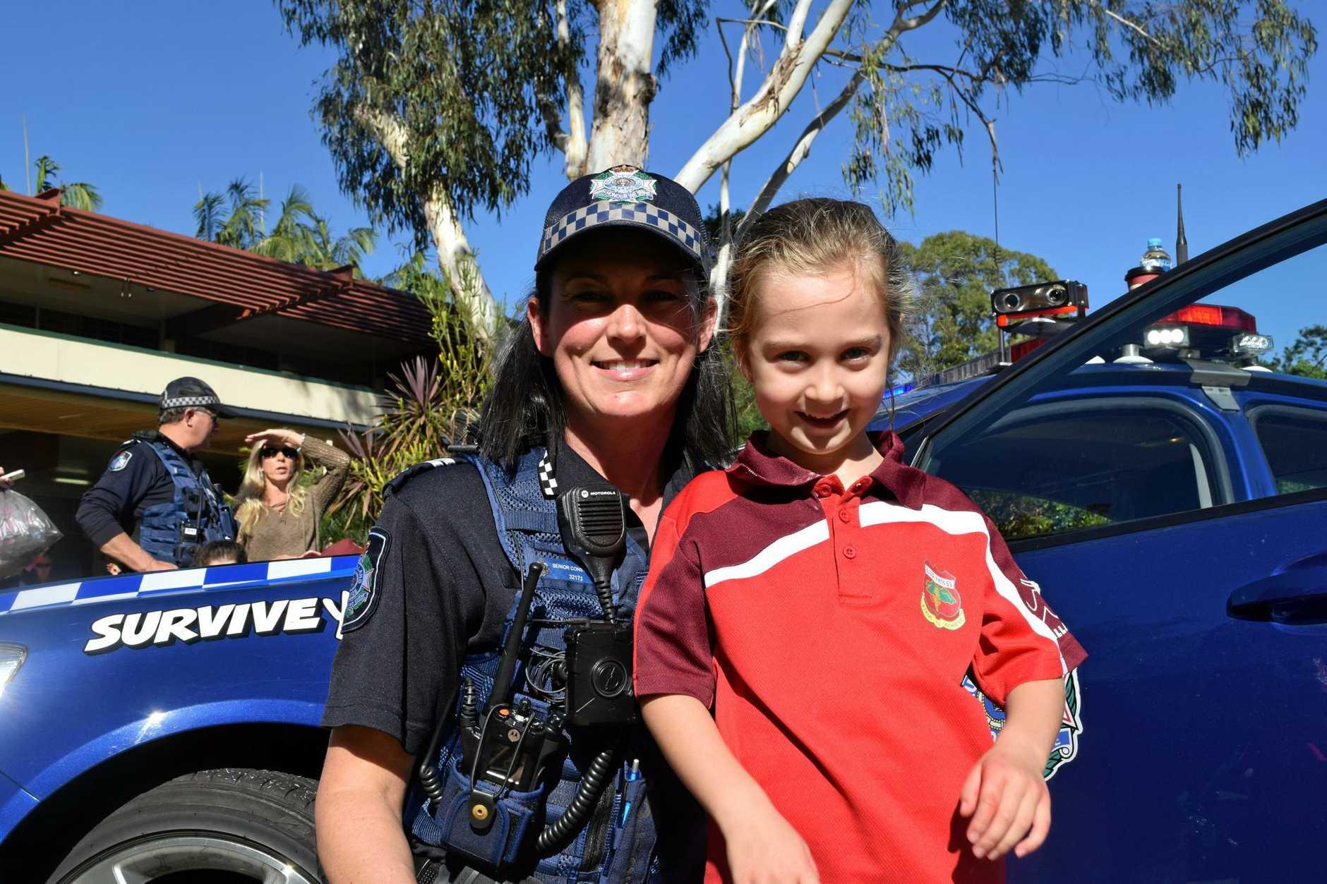 Senior Constable Jo MacAdams with Buderim Mountain State School student Olivia Dunstan (6).