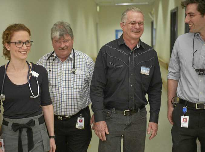 DEAD LUCKY: Bundamba man David Harris (second from right) was rushed to Ipswich Hospital with a rare type of meningococcal. Doctors Julia Kelly, Ian Brandon and Brendan Perry were part of the team who saved David's life.