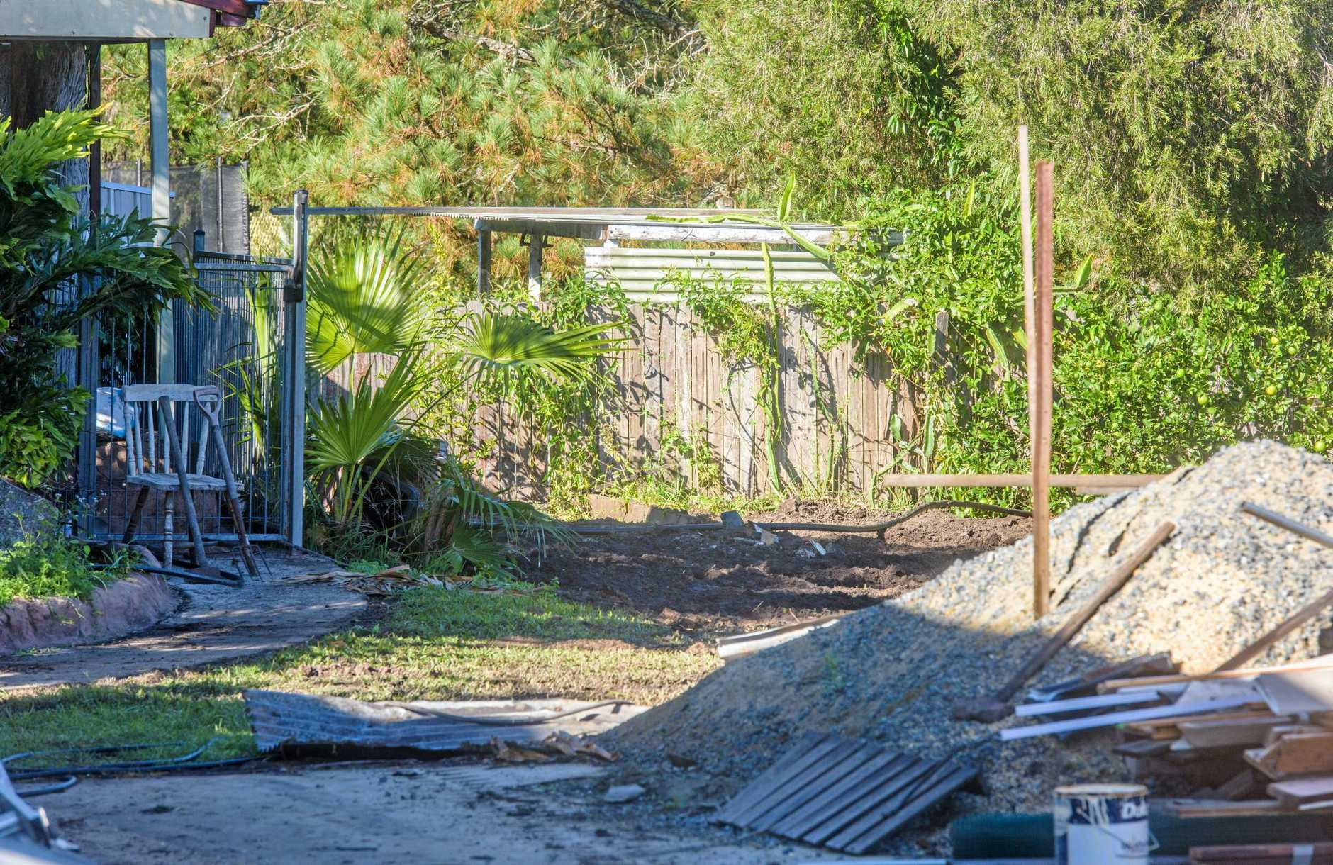 EXTENSIVE SEARCH: The yard at Lawrence that was excavated by police.