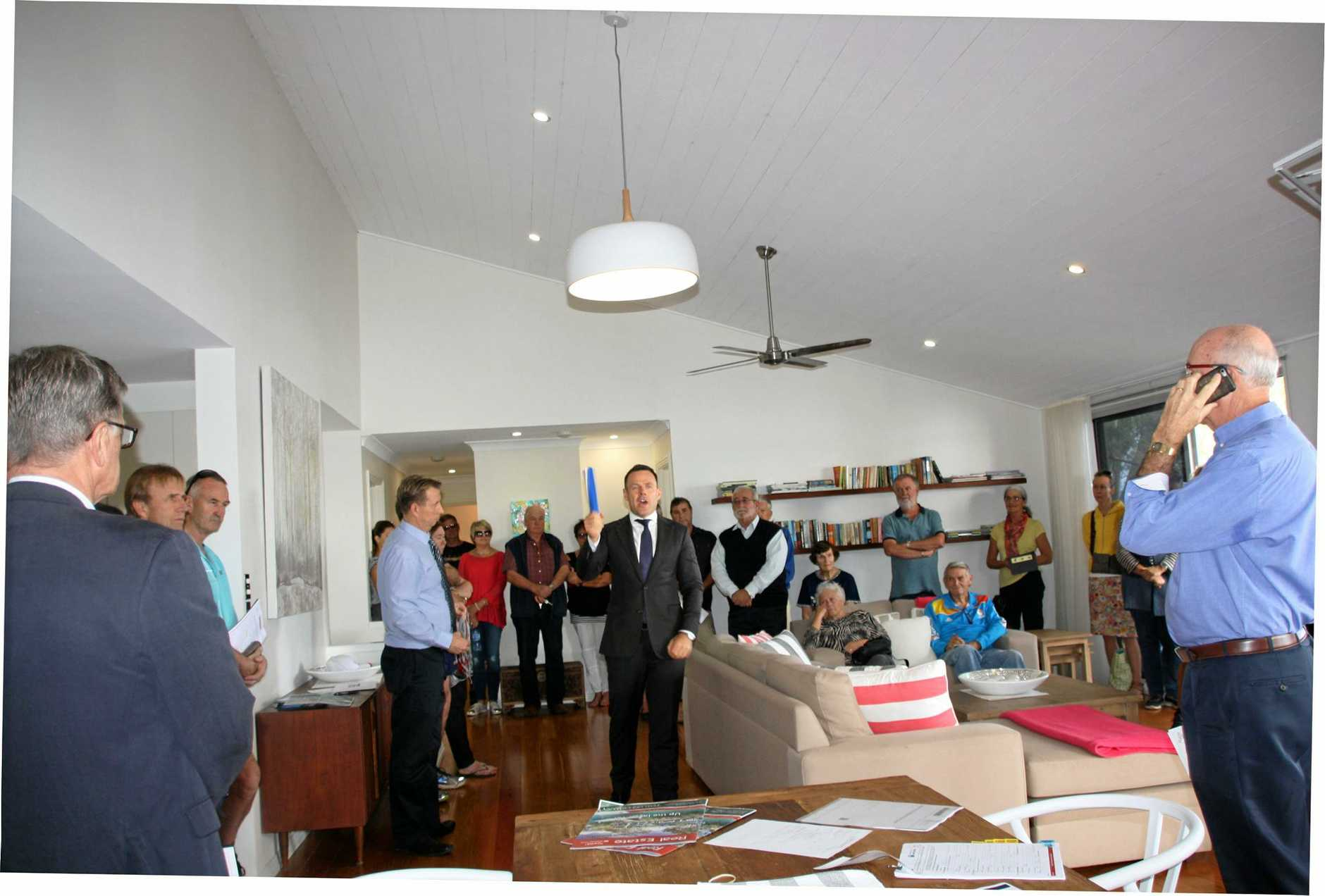 There was strong bidding and a crowd of about 70 for the auction of 4 River Gums, 3 Russell St, Noosaville.