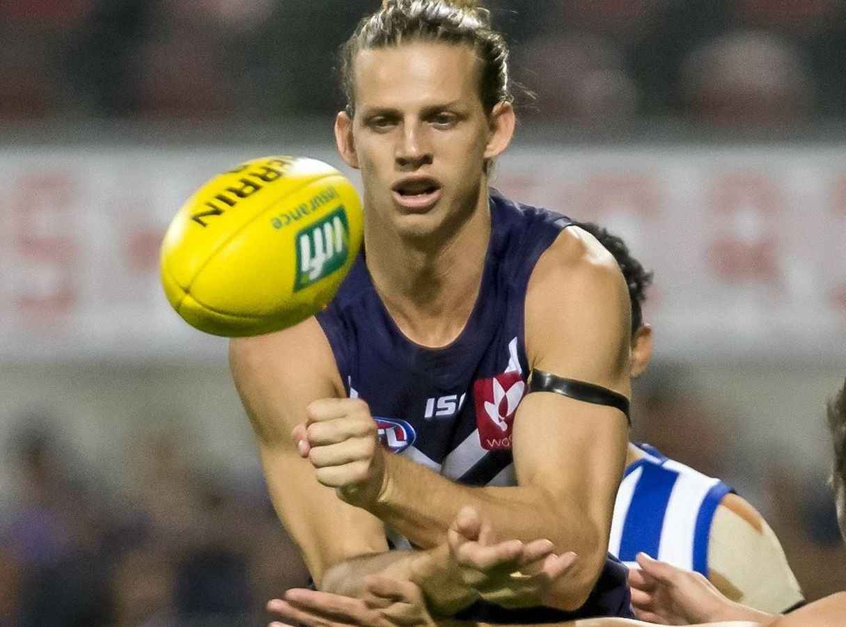 Dockers captain Nathan Fyfe gets a handball away against the Kangaroos.