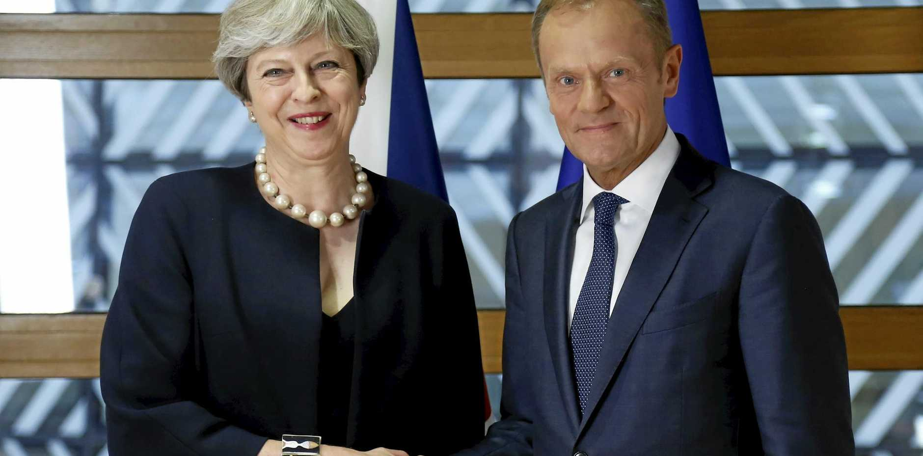 British Prime Minister Theresa May and European Council President Donald Tusk pose for photographers at an EU leaders summit in Brussels, Belgium.