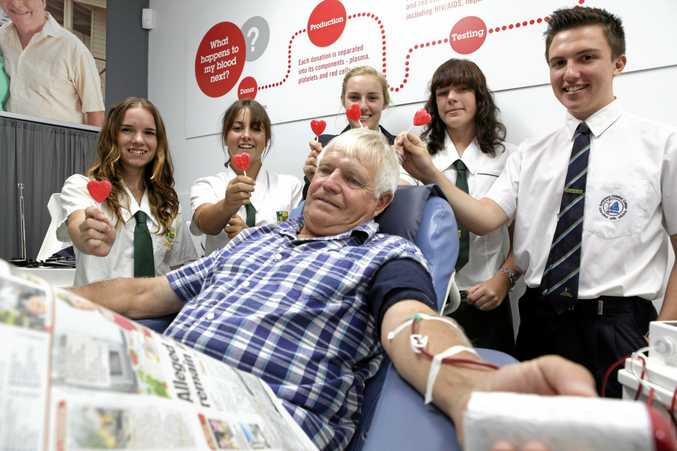 GIVE THE GIFT OF LIFE:  Local grade 12 students watch on as Michael Pullen gives a plasma donation at Bundaberg's Red Cross Blood Bank. Photo: Selina Ferrais / NewsMail