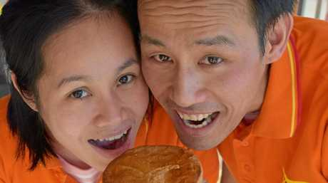 Ray Patisserie owner Leon Ly and Sandra Tran tuck into one of their award winning pies.