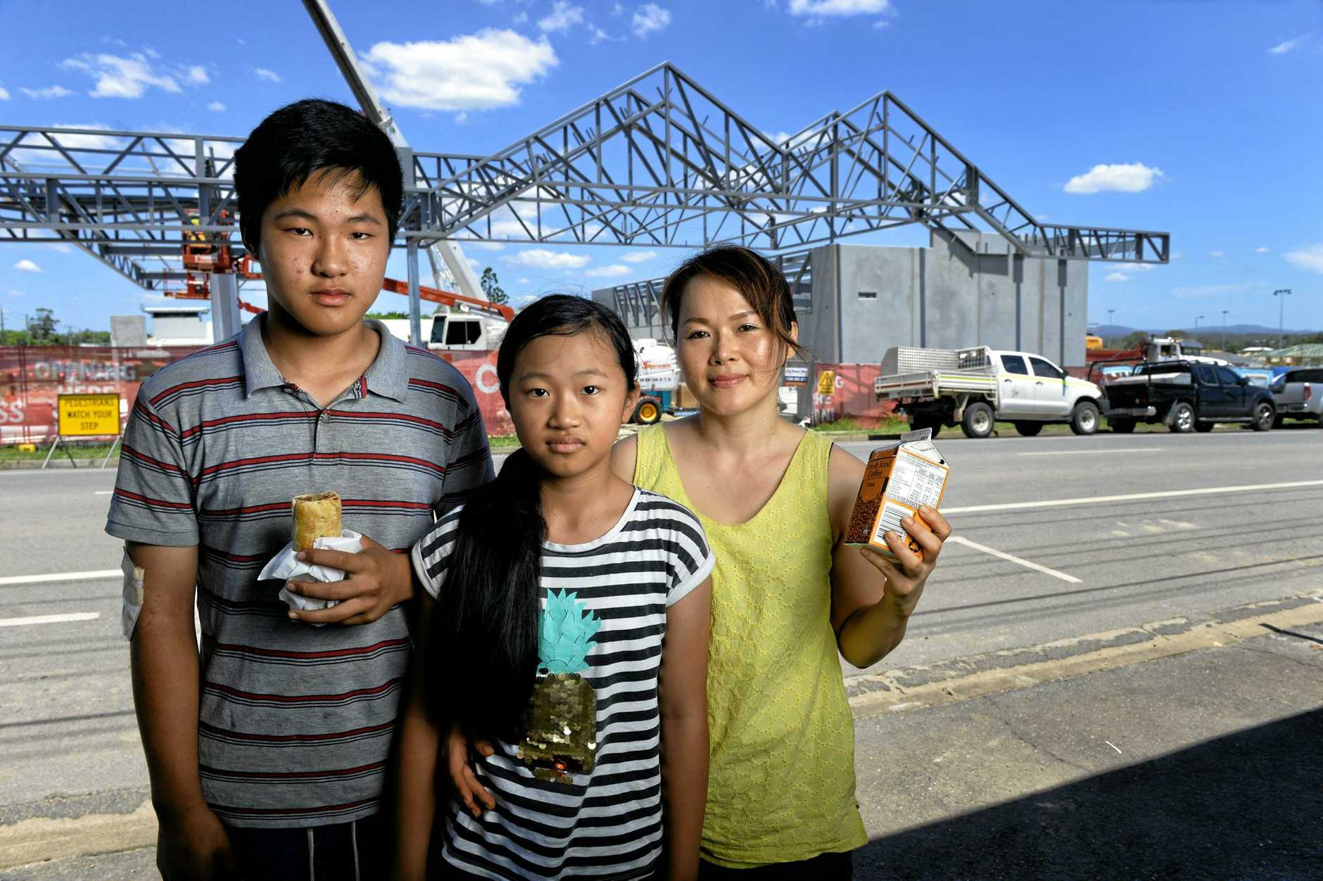 Johnny and Julie Nguyen and Tuyet Huynh from the Hot Bread Bin on Grange Road are concerned about how the development on the old Bremer High School site will affect their business.