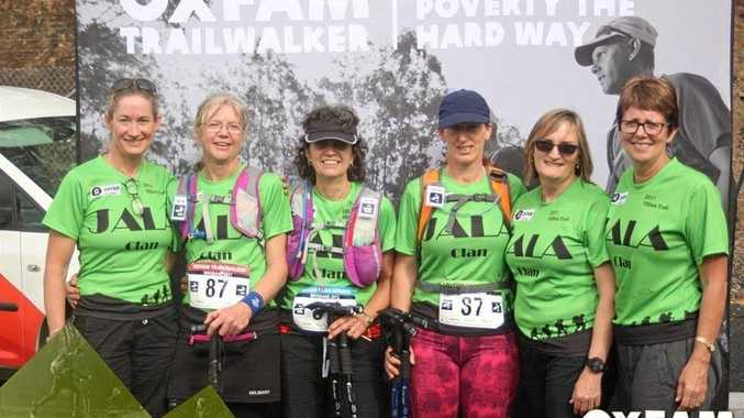 TRAIL OF GLORY: Rachel Close, Judi Gray, Annie Bradford, Avril Brown, Linda Coombes and Lyn McKillop finishing the 100km Oxfam trailwalk at Mt Coot-tha.
