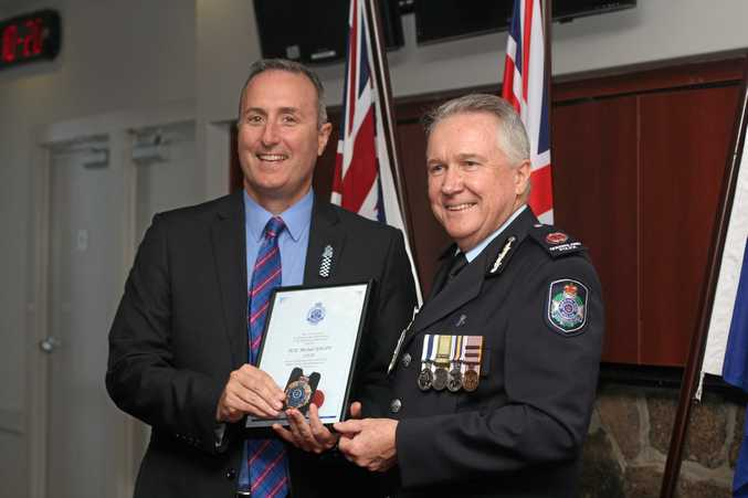 WELL DONE: Detective Senior Constable Michael Hauff was given the Detective's Appointment and Gold Badge by Southern Region Assistant Commissioner Tony Wright.