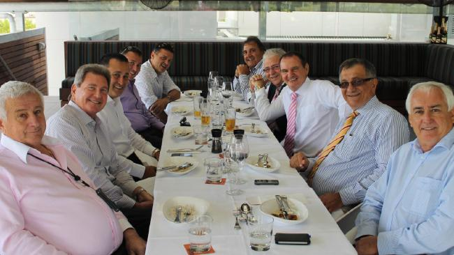 """Paul Pisasale (centre right) enjoys lunch with """"the rat pack"""", as he referred to the group in an RTI document in 2012."""