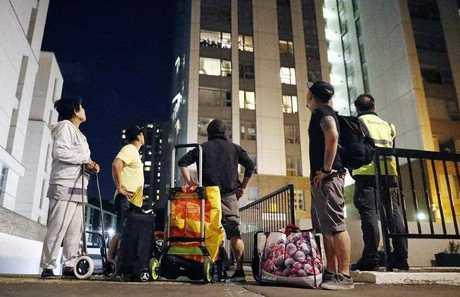 Residents evacuate Chalcots Estate tower blocks in Camden, London, Britain, 23 June 2017.