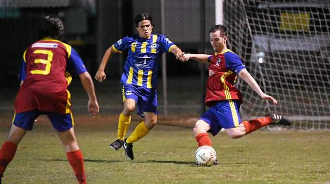 DEFEND: The Waves' Patrick Fennessy tries to win the ball from the KSS Jets.