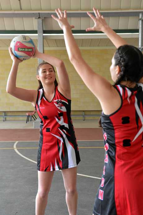STATE COMPETITION: Madison Hard and Grace Whaleboat train before the Queensland Independent Secondary Schools Netball Carnival in Brisbane.