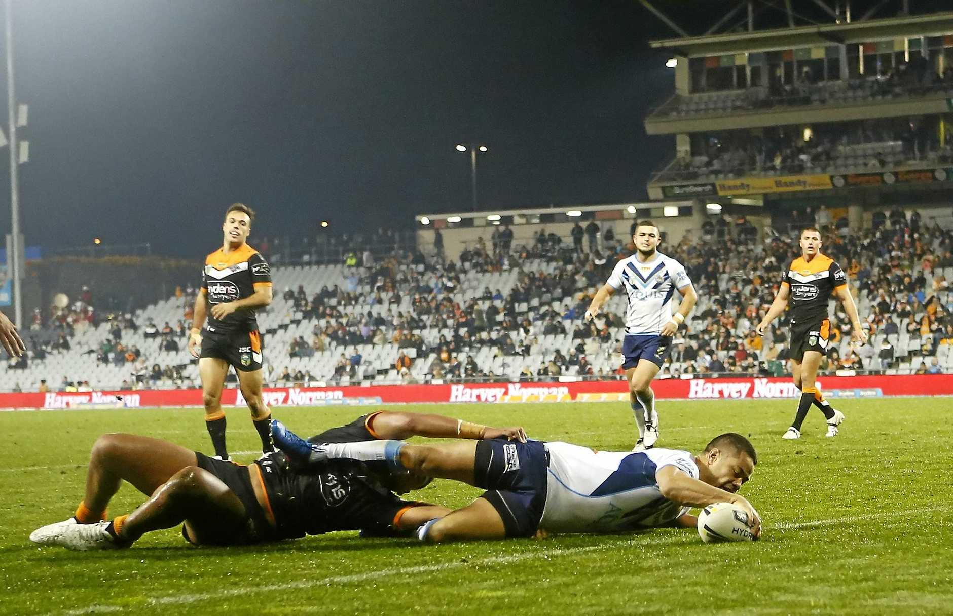 Jarryd Hayne of the Titans scores a try against the Tigers.