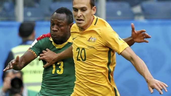 Christian Bassogog (left) of Cameroon and Trent Sainsbury of Australia.