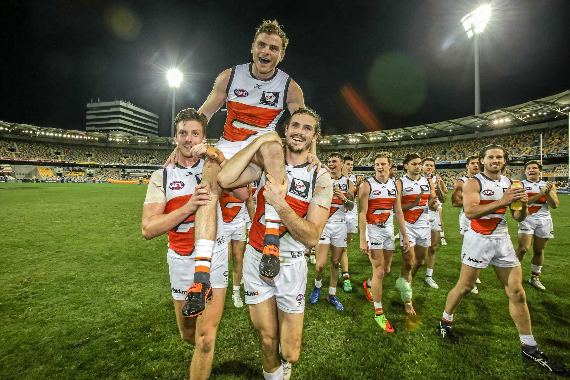 Heath Shaw of the Giants celebrates his 250th game during the Round 14 AFL match between the Brisbane Lions and the Greater Western Sydney (GWS) Giants at the Gabba in Brisbane, Saturday, June 24, 2017. (AAP Image/Glenn Hunt) NO ARCHIVING, EDITORIAL USE ONLY