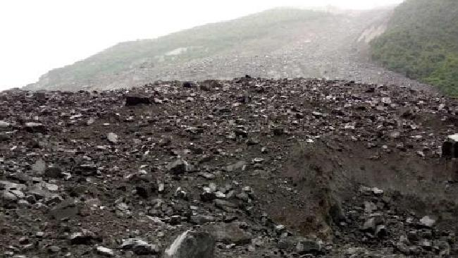 More than 100 people are feared buried in a major landslide in China.