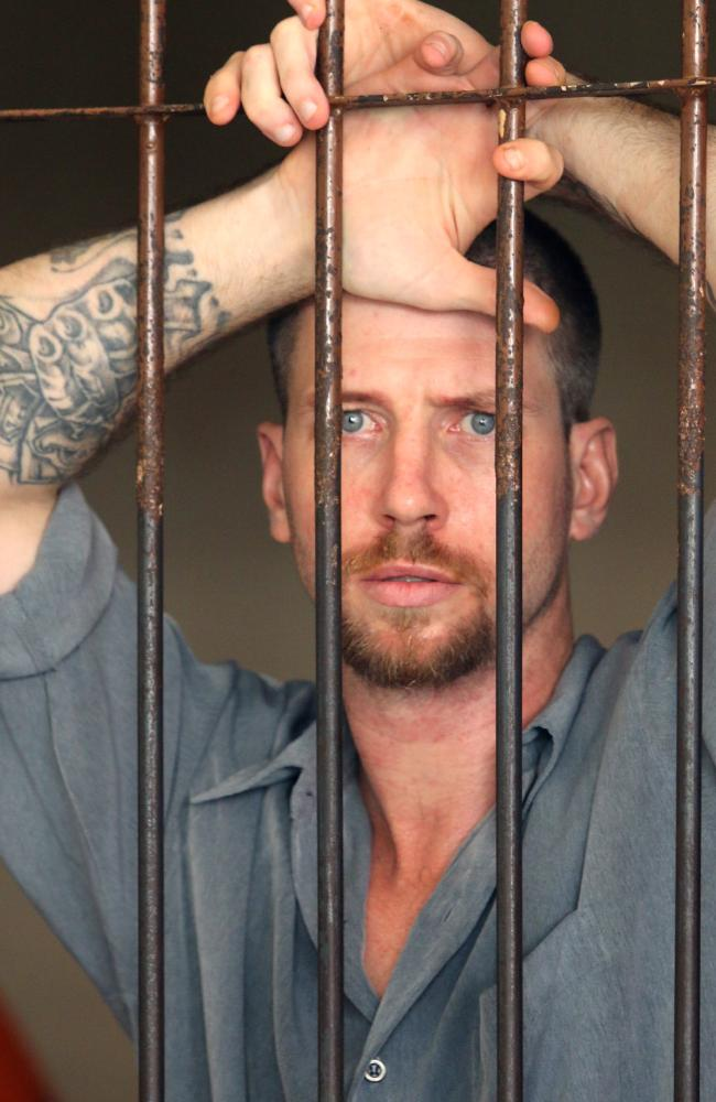 Australian Shaun Edward Davidson, 31, inside a Denpasar District Court cell waiting his first trial for using fake identification and overstaying in Bali.