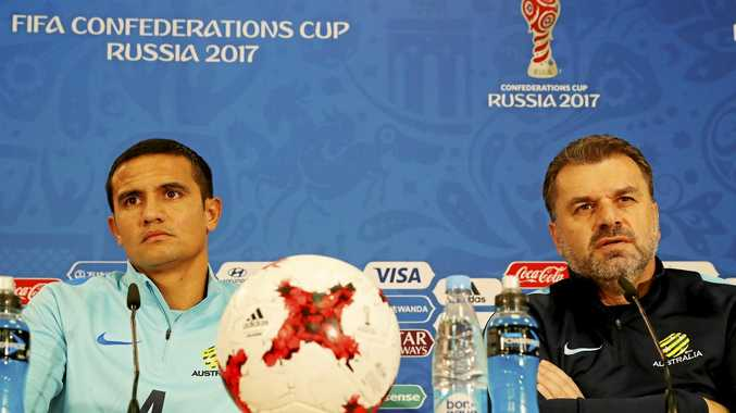 CHILE RECEPTION: Socceroos coach Ange Postecoglou (right) and veteran forward Tim Cahill faced tough questions from the Chilean media.
