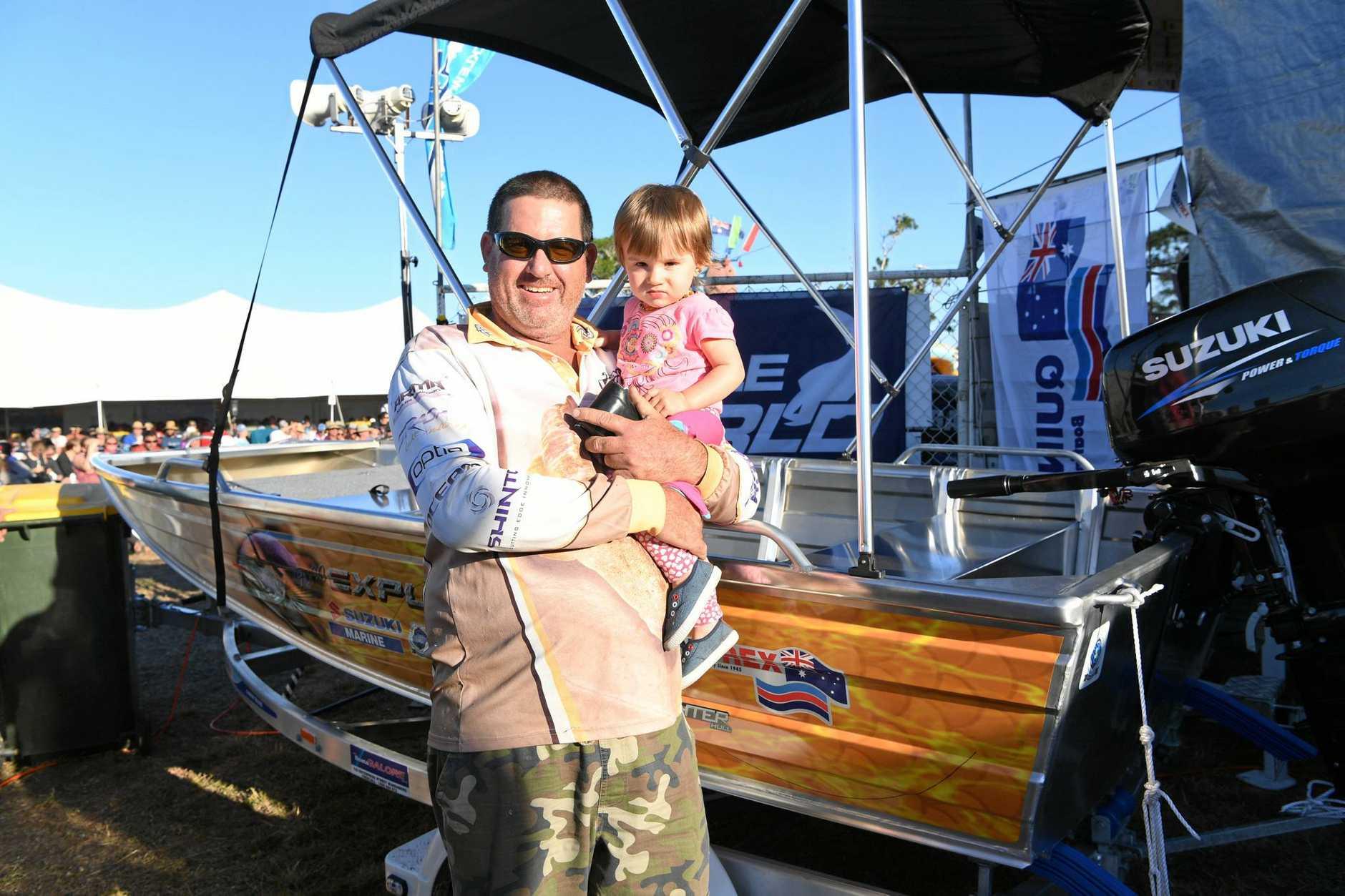 NEW BOAT: Chris and Cienna Evans win at the Bundaberg VMR Family Fishing Classic raffle.