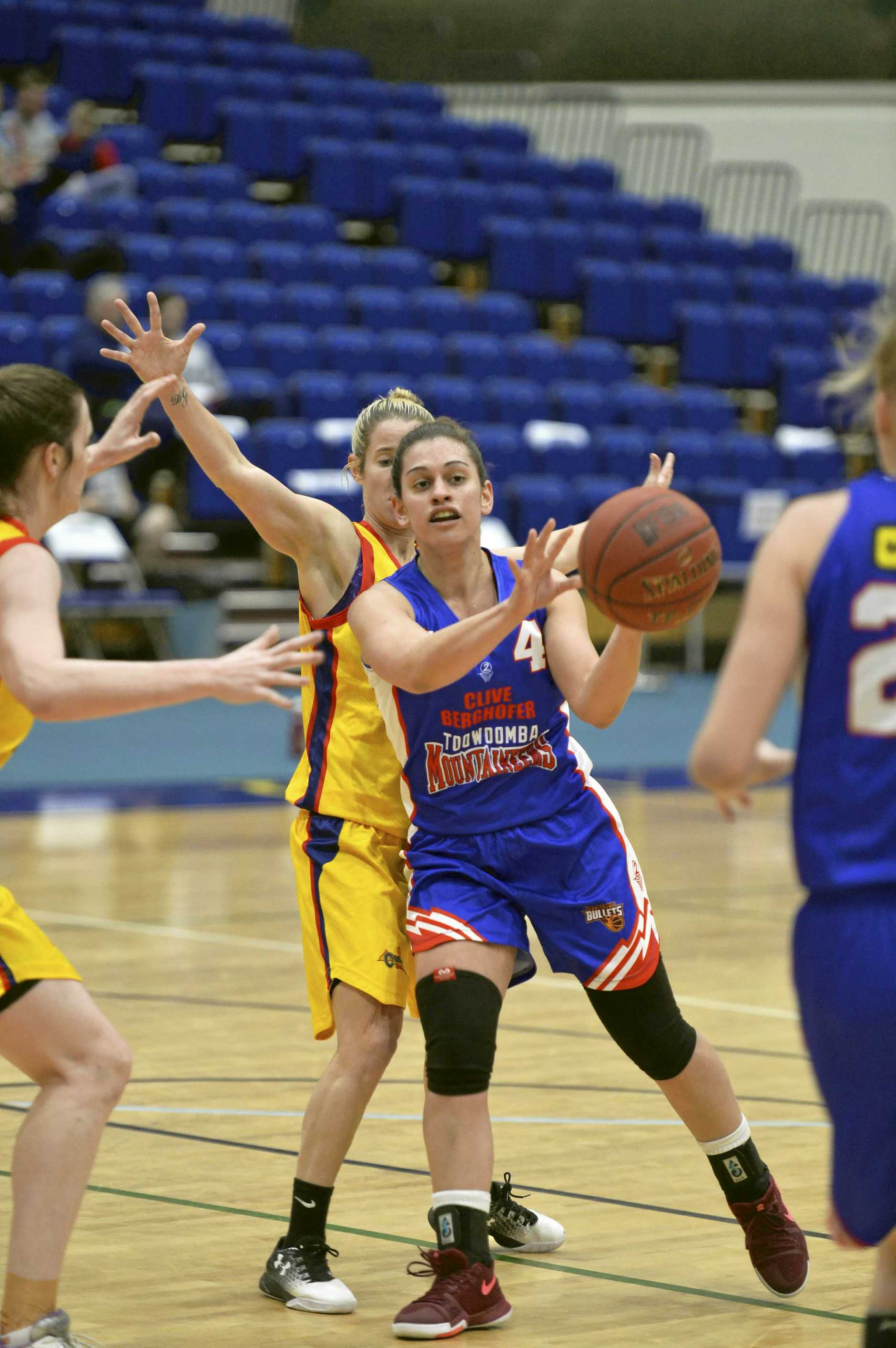 CLOSE CLASH: Toowoomba Mountaineers' Tracey Russell passes against Brisbane Capitals in QBL women's basketball at USQ's Clive Berghofer Recreation Centre.