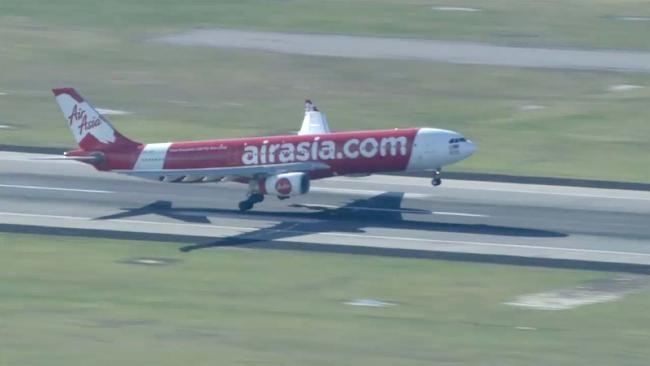 Air Asia plane turned back after emergency at Perth airport.