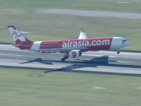 Pilot urges passengers to pray after AirAsia flight forced to turn around