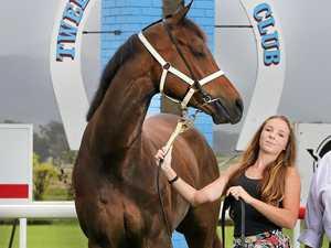 Tweed River Jockey Club chairman Bernie Quinn and apprentice jockey Corinne Miles promote a Melbourne Cup Day meeting.