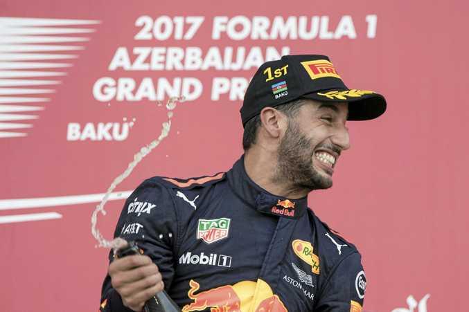 Daniel Ricciardo  celebrates on the podium in Baku, Azerbaijan