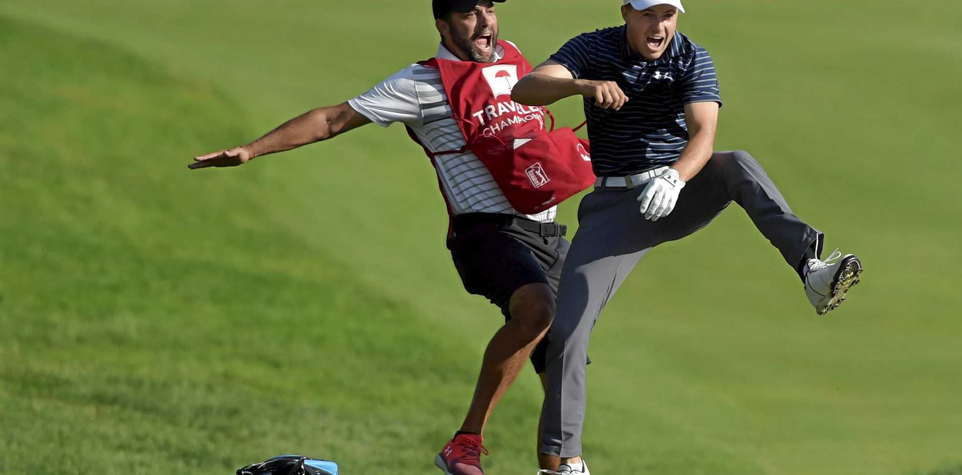 TOP SHOT: Jordan Spieth (right) celebrates with caddie Michael Greller after Spieth holed a bunker shot on a play-off hole to win the Travelers Championship.