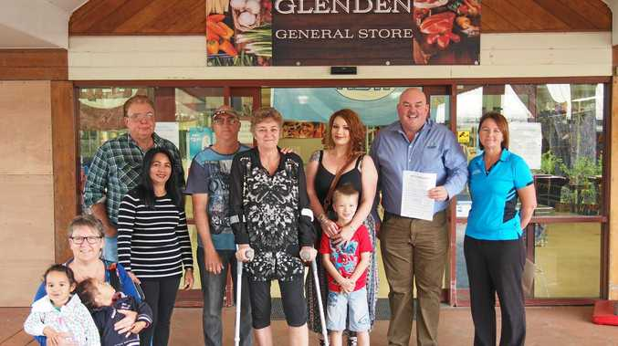 Mike Brunker (second from right) with Glenden residents who are getting behind a petition to save their community.