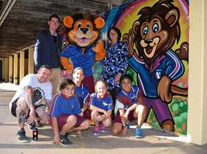STREET ART: Leichhardt State School deputy principal Aaron Clavan, principal Michelle Hamlin and students Reuben Sonio, Angelina Broughton, Mia Mason and Tafai Brownlie with graffiti artist Oliver Walker and the new school masterpiece.