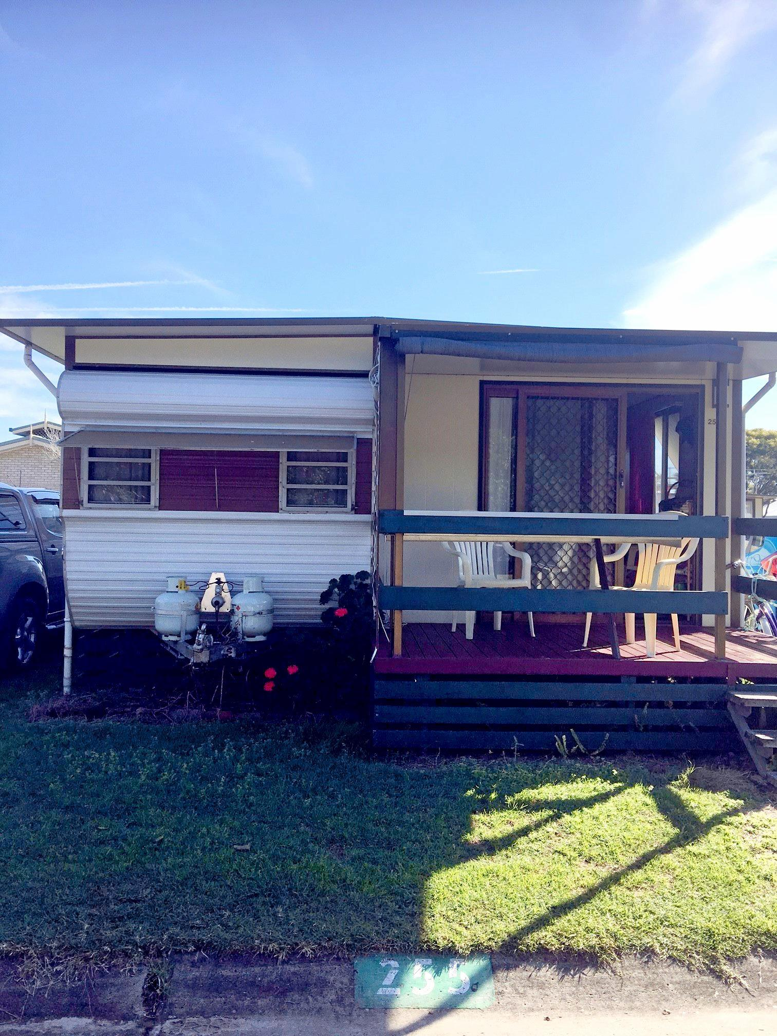 The Baker's caravan is one of the many vans at Evans Head Caravan Park that will either be sold off for $1000 or taken away by a tilt tray truck to move to scrap by September this year.