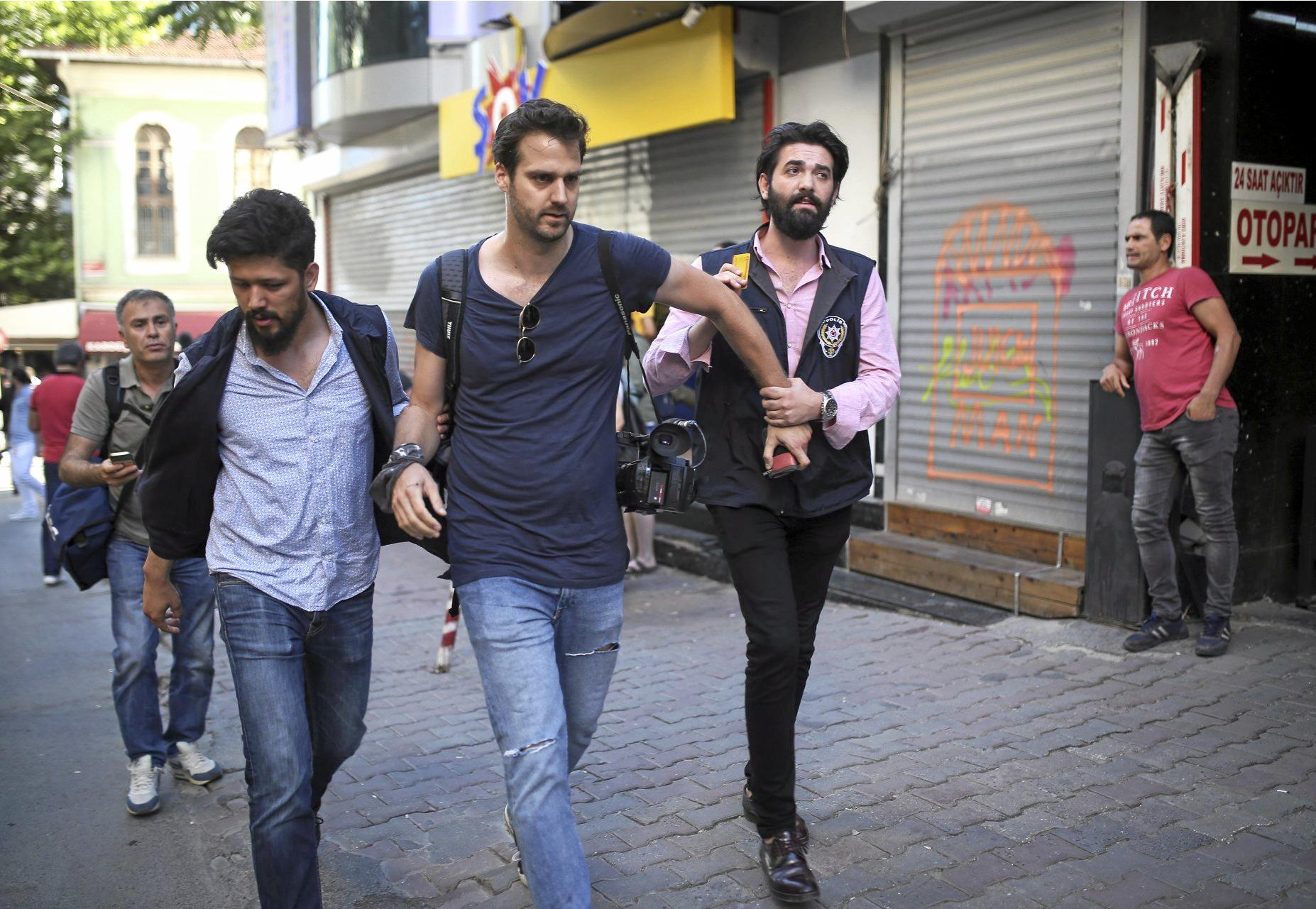 Turkish riot police detain Associated Press journalist Bram Janssen, stopping him from reporting on LGBT pride march in Istanbul.
