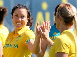 TEAM TIME: Emilee Cherry with her Australian rugby sevens team mates.