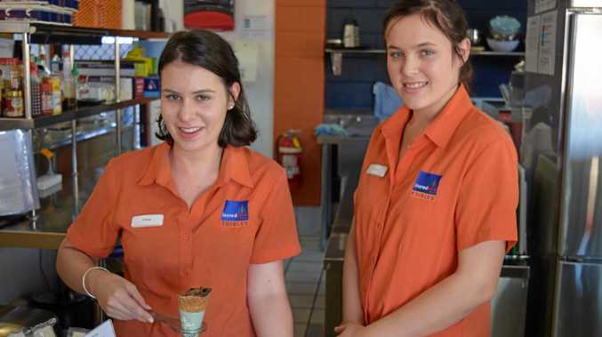 Workers at Paget cafe Incredable Edibles, Chloe Sheehy and Megan Humphreys, with the new 'coffee in a cone' product.
