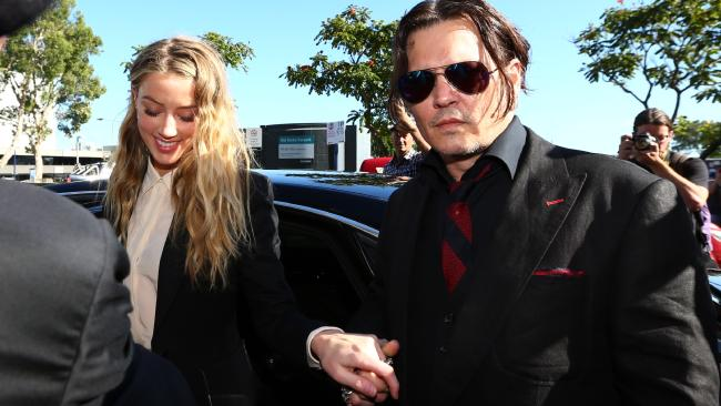 Johnny Depp with then-wife Amber Heard at Southport Court last year.