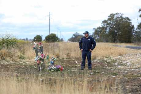 TEXTING KILLS: Sergeant Brett Stevenson at the scene of the fatal crash on the Dalby-Kogan Rd on October 29, 2012, that sticks with him still.