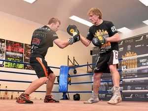 Jeff Horn (left) trains with Glenn Rushton during a training session in Brisbane.