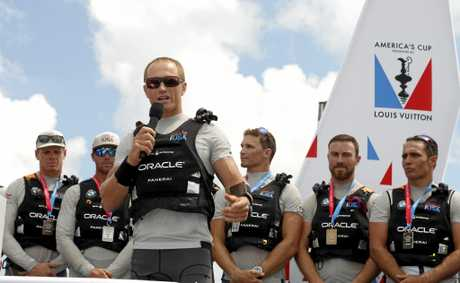 Oracle Team USA helmsman and skipper Jimmy Spithill acknowledges the crowd