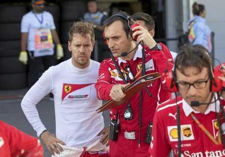 German Formula One driver Sebastian Vettel (left) is maintaining his innocence despite hitting rival driver Lewis Hamilton's car twice.