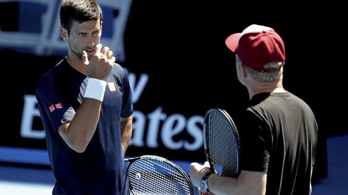 PRACTICE SESSION: Novak Djokovic chat to coach Boris Becker during a training session at last year's Australian Open. Djokovic has vowed to help his former coach in anyway possible after it rumours Becker was bankrupt began circulating.