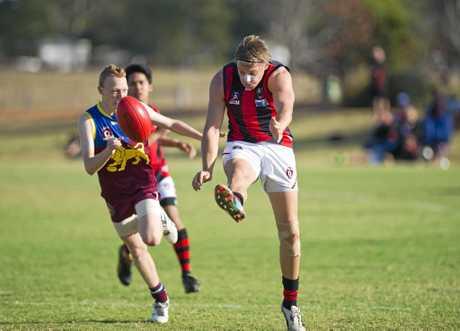 KICKING IN: John Leidig kicks forward for South Toowoomba.