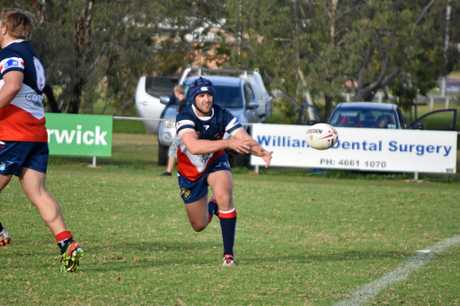 Morgan Taylor passes for the Warwick Cowboys at Father Ranger Oval.