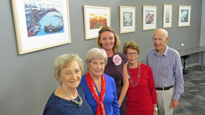Viewing the collection at the Dudley Denny City Library are (from left) artist Tony Druery's mother Anne Druery, Friends of Mackay Libraries treasurer Margaret Wright, Tony's widow Leanne Druery, Friends of Mackay Libraries president Robin McWhinney, and Tony's father Keith Druery.