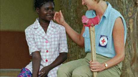 Diana, Princess of Wales talks to 13-year-old Sandra Thijica, who lost her leg to a land-mine in 1994 while working the land in Saurimo, eastern Angola, at the Neves Bendinha Orthopedic Workshop on the outskirts of Luanda.