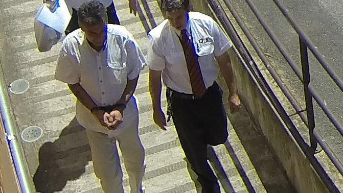 Damien Joseph Jelicic, left, following his arrest.