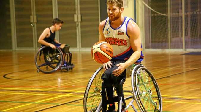 AUSTRALIAN REP: Steven Elliott in action for the Suncoast Spinners. Elliott is back in Australia after helping the Australian under-23 Basketball team .