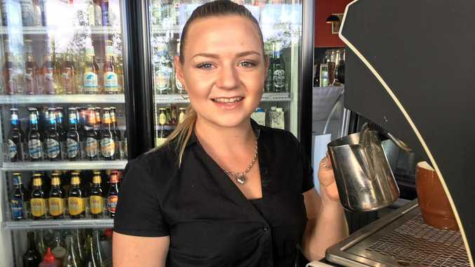 ELECTRICITY. Jade Dempsey is serving coffee at Metro Mackay. The heavy electricity user is paying the price for power.